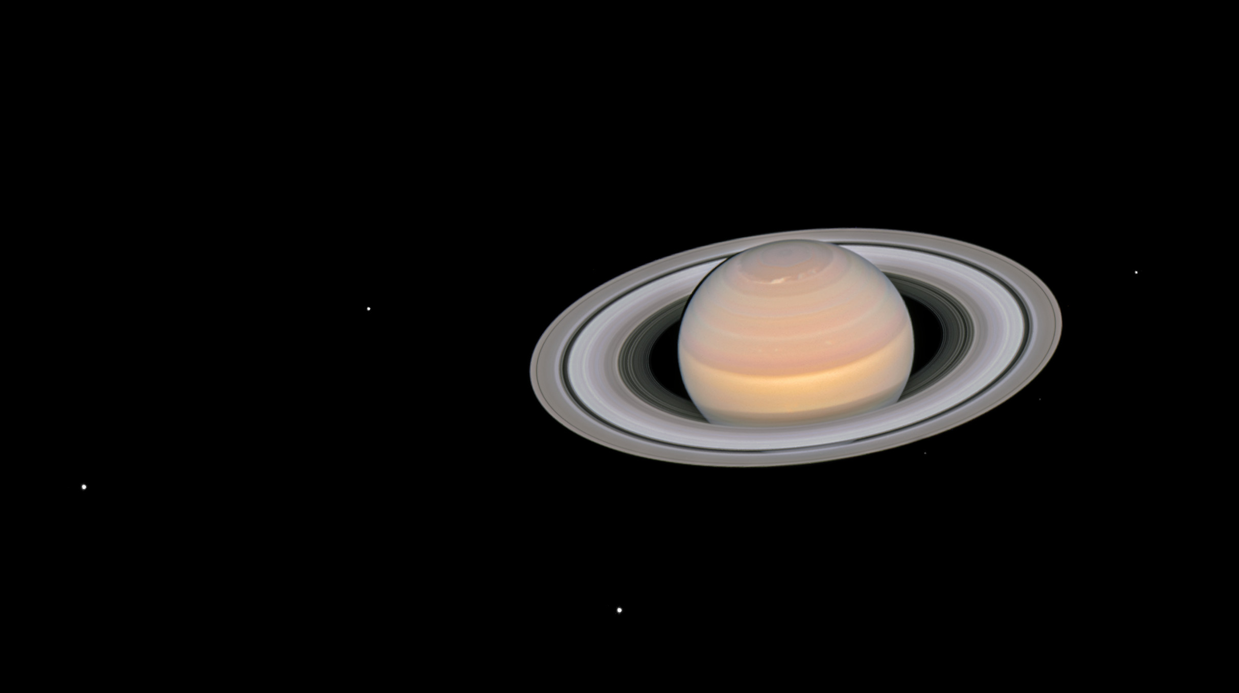 Hubble Space Telescope image of Saturn and several of its moons