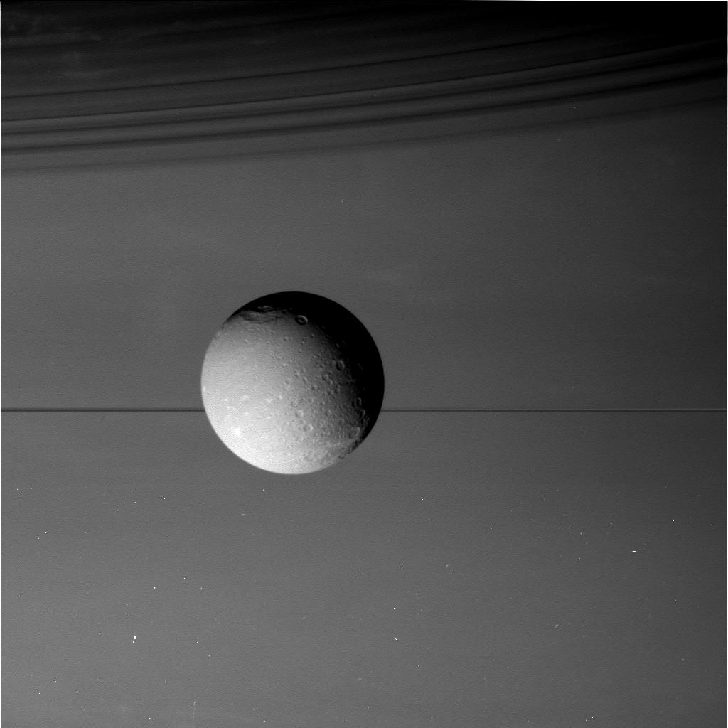 August 17, 2015, view of Saturn's moon Dione in front of the giant planet