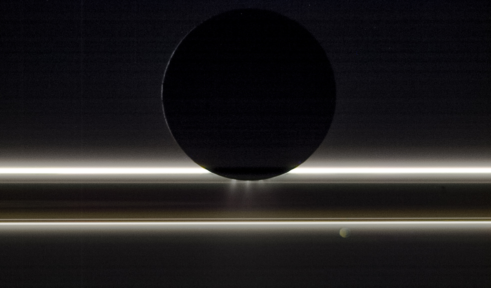Enceladus passes in front of Saturn's rings