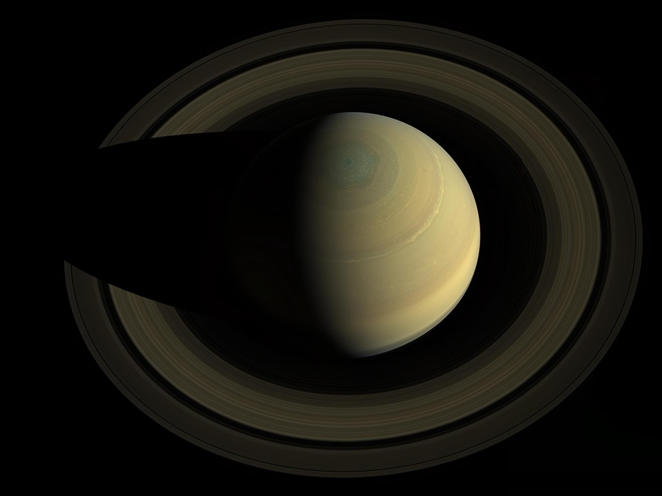 Saturn, its rings, and a hexagonal storm at its north pole, 2013