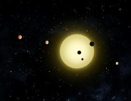 Artist's concept of a planetary system discovered by Kepler, with three planets 'transiting' the star NASA/Tim Pyle