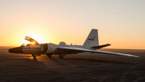 The Sun sets behind a NASA WB-57F Canberra research aircraft