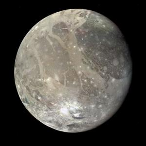 A mosaic of spacecraft images shows the varied surface of Ganymede