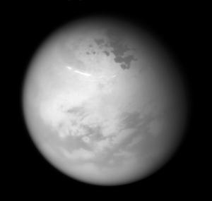 Cassini view of Titan lakes, clouds