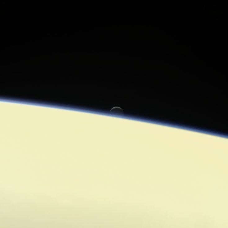 Enceladus sets behind Saturn