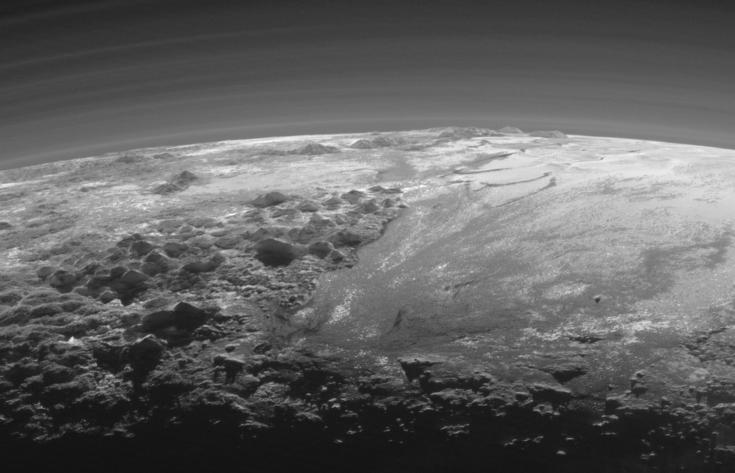 Backlit view of Pluto landscape from New Horizons