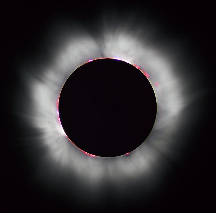 The Sun's corona shines around the intervening Moon during a total solar eclipse
