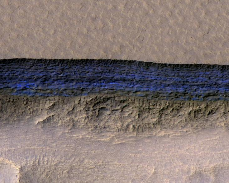 Layers of buried ice exposed on a Martian slope