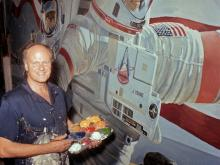 Robert McCall works on a space mural